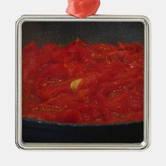 Cooking homemade tomato sauce using fresh tomatoes metal ornament