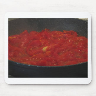 Cooking homemade tomato sauce using fresh tomatoes mouse pad