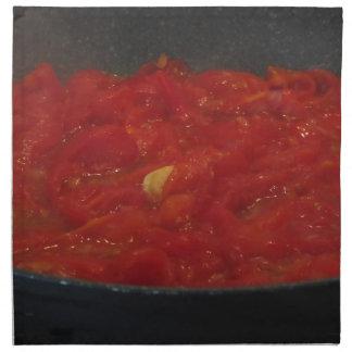 Cooking homemade tomato sauce using fresh tomatoes napkin
