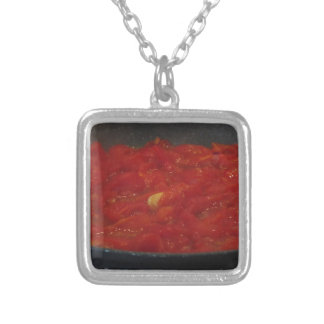 Cooking homemade tomato sauce using fresh tomatoes silver plated necklace