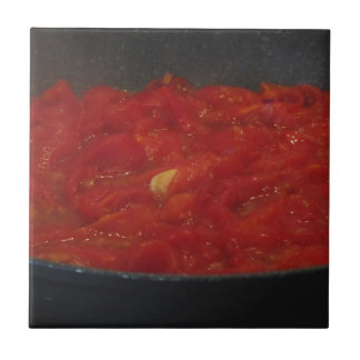 Cooking homemade tomato sauce using fresh tomatoes tile