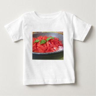 Cooking homemade tomato sauce using tomatoes baby T-Shirt