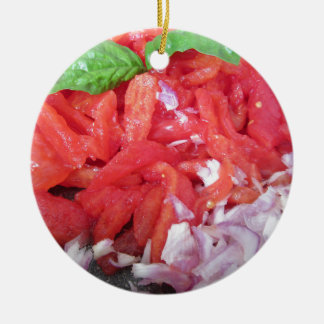 Cooking homemade tomato sauce using tomatoes ceramic ornament