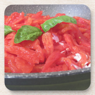 Cooking homemade tomato sauce using tomatoes coaster