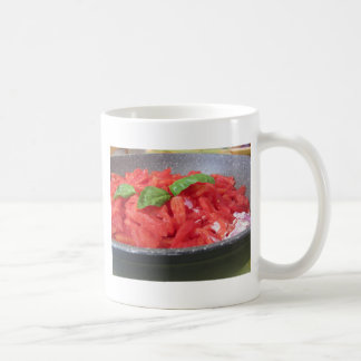 Cooking homemade tomato sauce using tomatoes coffee mug