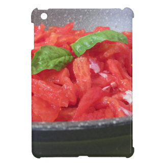 Cooking homemade tomato sauce using tomatoes cover for the iPad mini