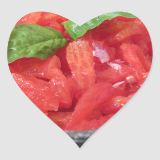 Cooking homemade tomato sauce using tomatoes heart sticker