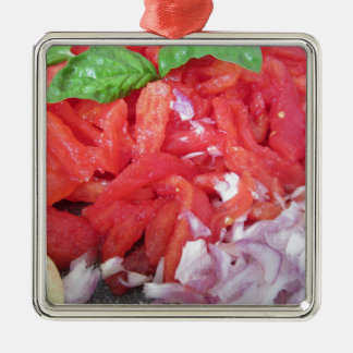 Cooking homemade tomato sauce using tomatoes metal ornament