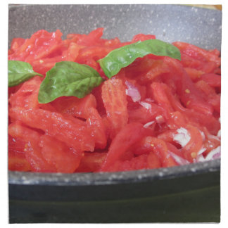 Cooking homemade tomato sauce using tomatoes napkin