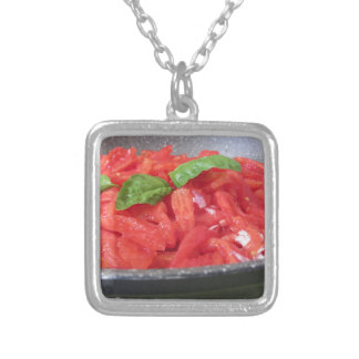 Cooking homemade tomato sauce using tomatoes silver plated necklace