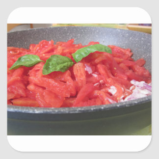 Cooking homemade tomato sauce using tomatoes square sticker
