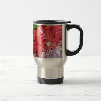 Cooking homemade tomato sauce using tomatoes travel mug