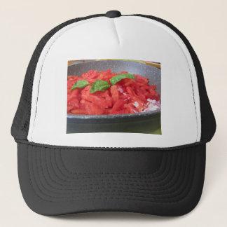 Cooking homemade tomato sauce using tomatoes trucker hat