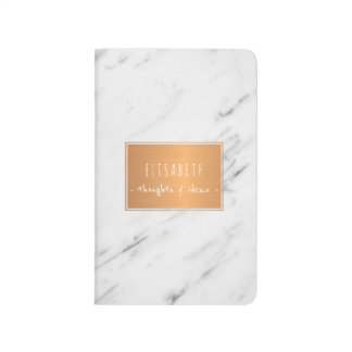 Copper label on white marble stylish notes journal