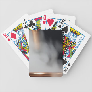copper pipe of a distillery with steam. bicycle playing cards