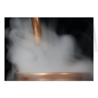 copper pipe of a distillery with steam. card