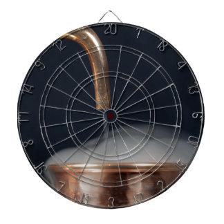 copper pipe of a distillery with steam. dartboard