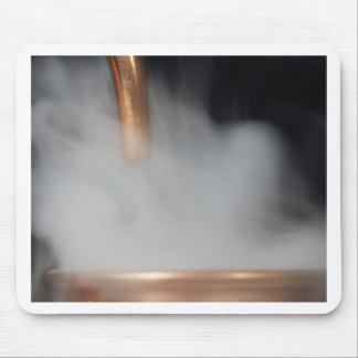 copper pipe of a distillery with steam. mouse pad