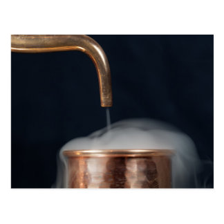 copper pipe of a distillery with steam. postcard