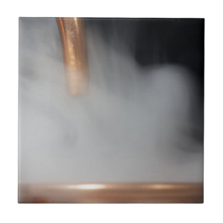copper pipe of a distillery with steam. tile