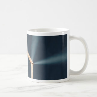 Copper pipes with a leak and steam. coffee mug