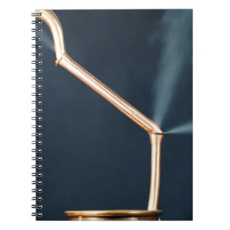 Copper pipes with a leak and steam. notebook