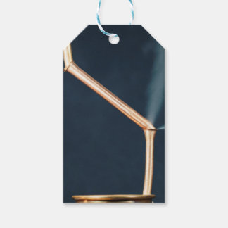 Copper pipes with a leak and steam. pack of gift tags