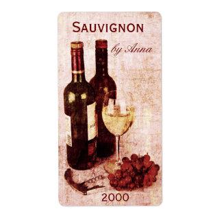 corkscrew, wine glass and grapes wine bottle label
