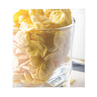 Corn flakes and glass of milk notepad