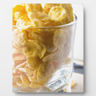 Corn flakes and glass of milk plaque