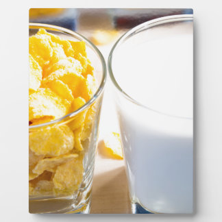 Cornflakes and milk for breakfast plaque