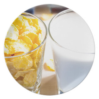 Cornflakes and milk for breakfast plate