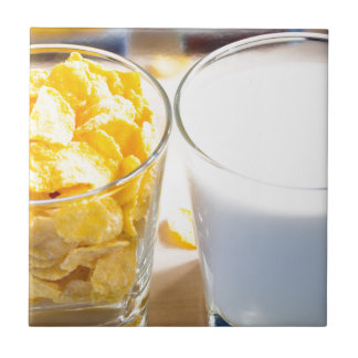 Cornflakes and milk for breakfast tile