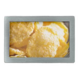 Cornflakes in a transparent bowl closeup belt buckles