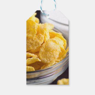 Cornflakes in a transparent bowl closeup gift tags