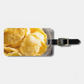 Cornflakes in a transparent bowl closeup luggage tag