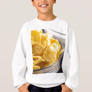 Cornflakes in a transparent bowl closeup sweatshirt