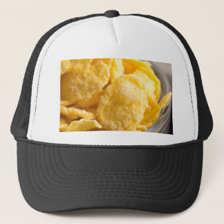 Cornflakes in a transparent bowl closeup trucker hat