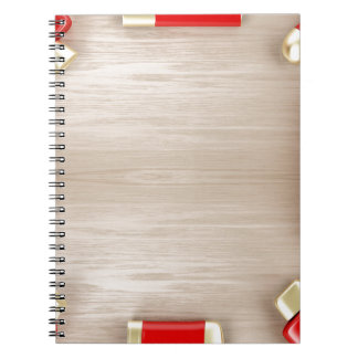 Cosmetic products on wooden table notebook