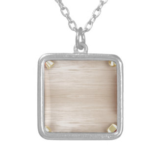 Cosmetic products on wooden table silver plated necklace