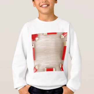Cosmetic products on wooden table sweatshirt