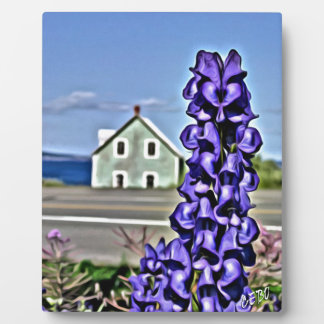 Cosy little house by the sea with a lupine flower plaque