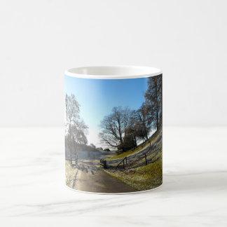 Country lane in a frosty landscape basic white mug