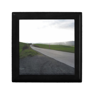 Country road over rolling green hills and valleys gift box