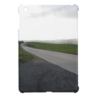 Country road over rolling green hills and valleys iPad mini case
