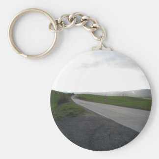 Country road over rolling green hills and valleys keychain