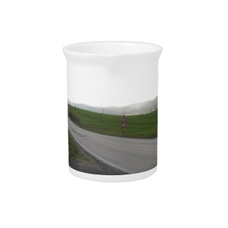 Country road over rolling green hills and valleys pitcher