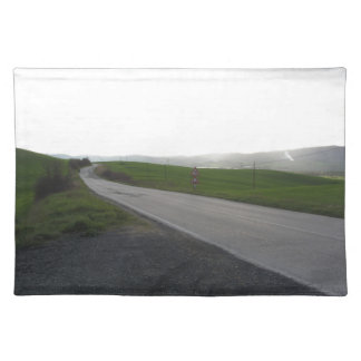 Country road over rolling green hills and valleys placemat