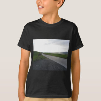 Country road over rolling green hills and valleys T-Shirt