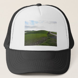 Country road over rolling green hills and valleys trucker hat